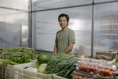 """Ni Guangxuan, 28, from Qinhuangdao, Hebei province. He's a trainee of the Little Donkey Farm (Shi Yan's first farm), and as part of the trainee program, he's working at Shared Harvest for 6 months. He used to be a cook, and tried to run his own organic farm in Qinhuangdao between 2014 and 2018. He joined the trainee program to learn more about organic farming and how it works on a big farm. """"I did everything myself on my farm, from farming to harvest, from packaging to sales, all by myself. Here everyone has their own job. There's a clear division of labor."""" In the future, he hopes to open his own farm that's supported by restaurants, inspired by the concept of Restaurant Supported Agriculture."""