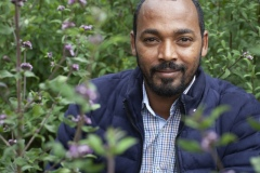 Dr Hiyab - 34 Vice Director for Research at The Gullele Botantical Gardens, Addis Ababa, Ethiopia with a Purple fragrant - lipid adoensis.